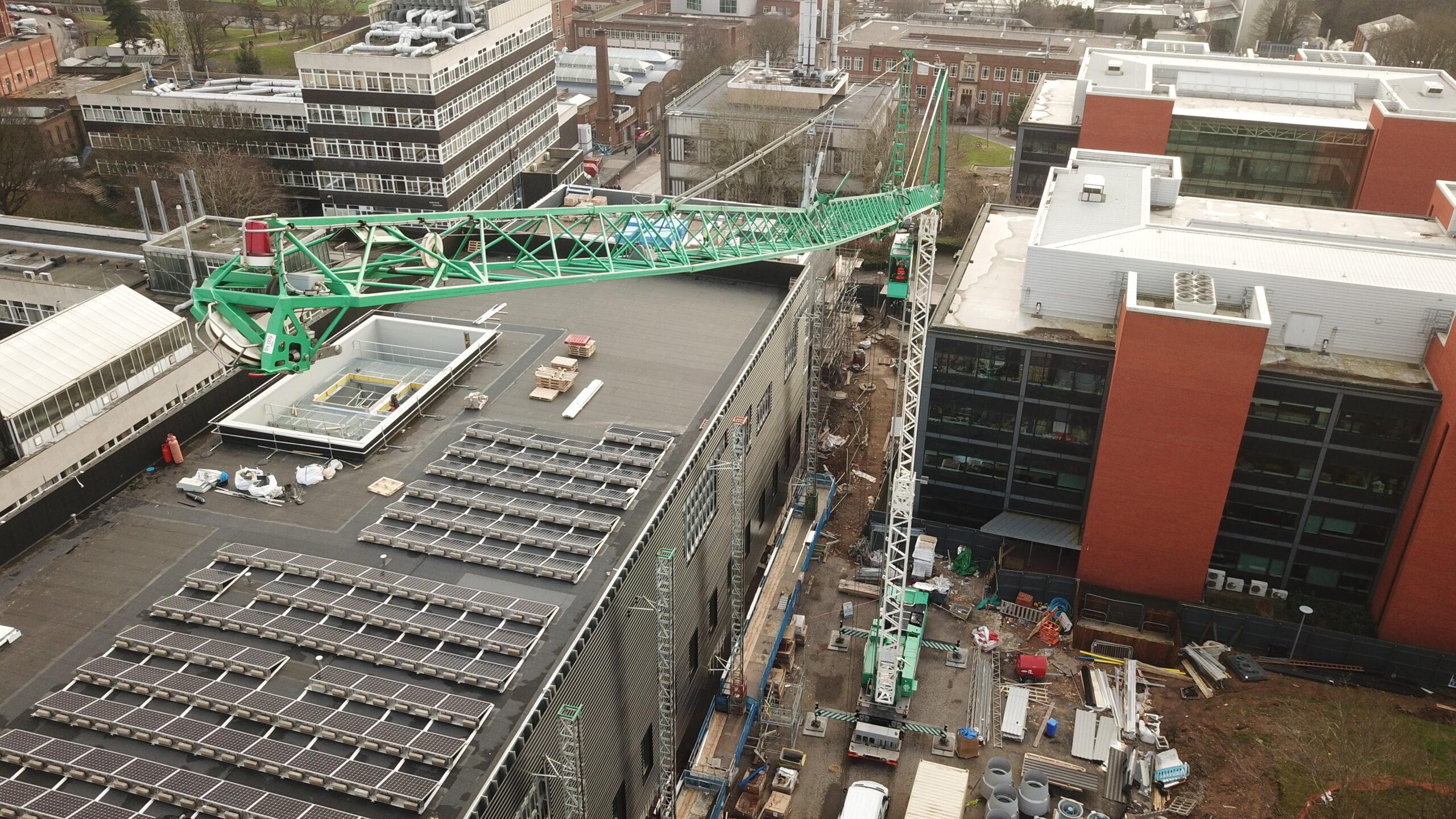 Crane constructing solar panels
