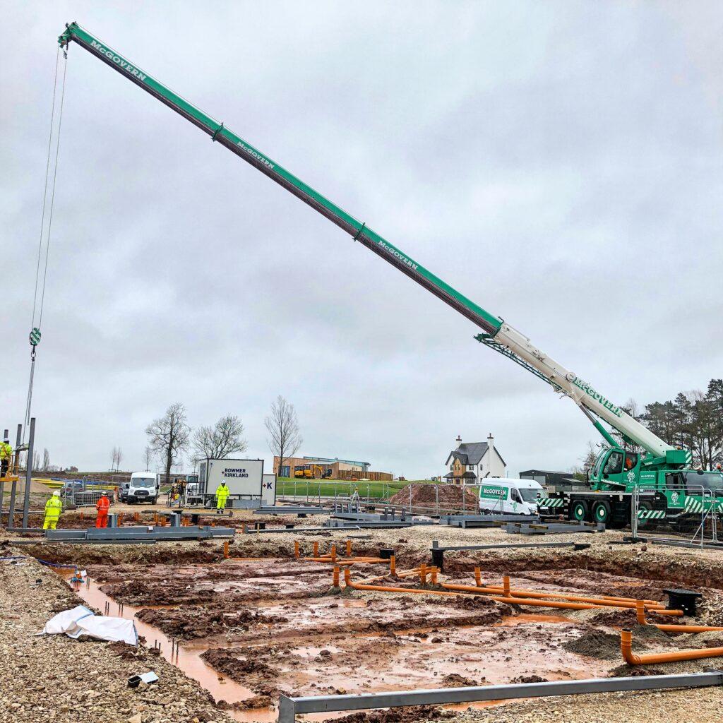 Crane laying foundations
